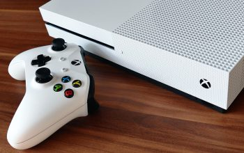 You are faced with a choice — A PS4 or an Xbox One — Which way to go?